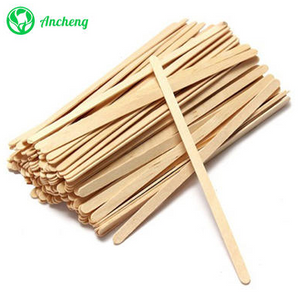 wooden coffee stirrer.png